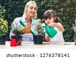 mother with little daughter... | Shutterstock . vector #1276378141