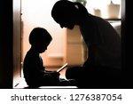 mother teaching son  learning...   Shutterstock . vector #1276387054