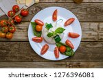 salad with buratta cheese  | Shutterstock . vector #1276396081