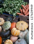 Pumpkin, Carrot and Sprouts for Sale on Market Stall - stock photo
