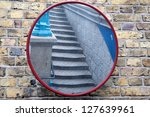 Stairs in Mirror on Brick Wall - stock photo