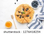 blini or crepes with fresh... | Shutterstock . vector #1276418254