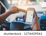 driver sitting in the car and... | Shutterstock . vector #1276429561