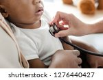 baby visiting the doctor for a... | Shutterstock . vector #1276440427
