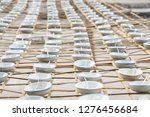 small cups lined up on bamboo. | Shutterstock . vector #1276456684