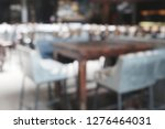 blur empty tables in street... | Shutterstock . vector #1276464031