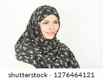 smiling girl in hijab covering... | Shutterstock . vector #1276464121