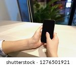 photo female hands holding a...   Shutterstock . vector #1276501921