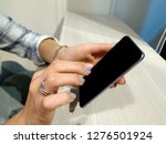 photo female hands holding a...   Shutterstock . vector #1276501924