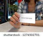 photo female hands holding...   Shutterstock . vector #1276502701