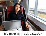 business trip asian woman... | Shutterstock . vector #1276512037