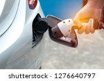 hand holding electric charger... | Shutterstock . vector #1276640797
