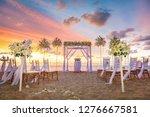 Beach Ceremony Setup With...