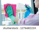 cleaning concept. asian woman... | Shutterstock . vector #1276682224