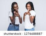 two cheerful african girls...   Shutterstock . vector #1276688887