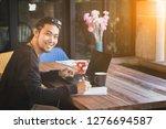 asian freelance man write on... | Shutterstock . vector #1276694587