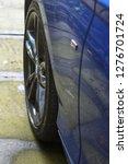 car wheel dark alloys blue car | Shutterstock . vector #1276701724