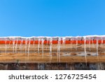 icicles hang from a rooftop... | Shutterstock . vector #1276725454