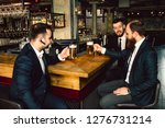 three young businessman sit at... | Shutterstock . vector #1276731214