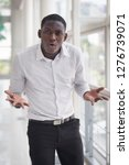 angry african man shrugging... | Shutterstock . vector #1276739071