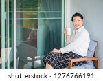 woman sitting in armchair and... | Shutterstock . vector #1276766191