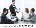 business team discussing a... | Shutterstock . vector #1276785637