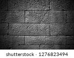 stone wall background in black...   Shutterstock . vector #1276823494