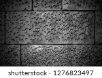 stone wall background in black...   Shutterstock . vector #1276823497