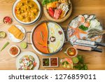 seafood sashimi with ice ready... | Shutterstock . vector #1276859011