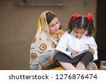 rural mother helping daughter... | Shutterstock . vector #1276876474
