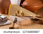 a piece of fresh tasty cheese... | Shutterstock . vector #1276880887