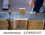 bricklayer at work in a... | Shutterstock . vector #1276902157