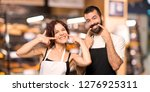 couple of cooks smiling with a... | Shutterstock . vector #1276925311