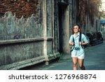 asian woman traveler wearing... | Shutterstock . vector #1276968874