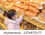 cute toddler girl in bakery... | Shutterstock . vector #1276972177