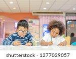 little toddler girl and boy... | Shutterstock . vector #1277029057