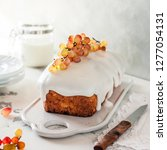 loaf cake with sugar icing and... | Shutterstock . vector #1277054131