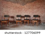 4 chairs at brick wall | Shutterstock . vector #127706099