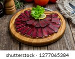 dried sliced basturma on the... | Shutterstock . vector #1277065384