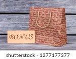 paper shopping bag on wooden... | Shutterstock . vector #1277177377