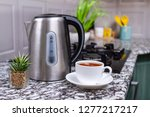 brewed tea in a white cup and... | Shutterstock . vector #1277217217