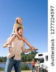 father carrying daughter on... | Shutterstock . vector #1277224597