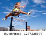 competitive female athlete... | Shutterstock . vector #1277228974
