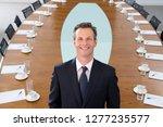 mature businessman at head of... | Shutterstock . vector #1277235577