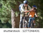 active father and daughter... | Shutterstock . vector #1277246431