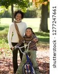 smiling mother with daughter... | Shutterstock . vector #1277247661