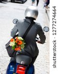 man on scooter in city carrying ... | Shutterstock . vector #1277274664