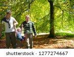 family walking in countryside... | Shutterstock . vector #1277274667