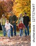 multi generation family on walk ... | Shutterstock . vector #1277274697