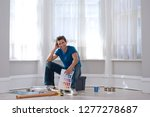 man decorating room with paint... | Shutterstock . vector #1277278687